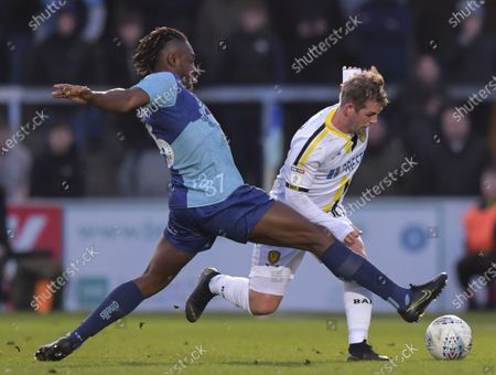 Anthony Stewart of Wycombe Wanderers tackles David Templeton of Burton Albion