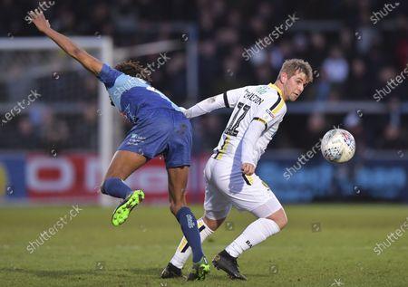Stock Image of David Templeton of Burton Albion turns Sido Jombati of Wycombe Wanderers