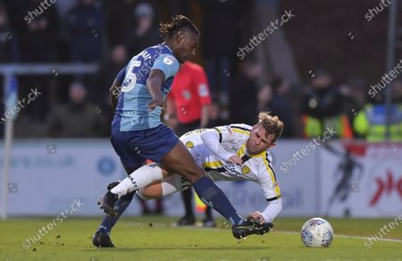 David Templeton of Burton Albion goes down under the challenge from Anthony Stewart of Wycombe Wanderers