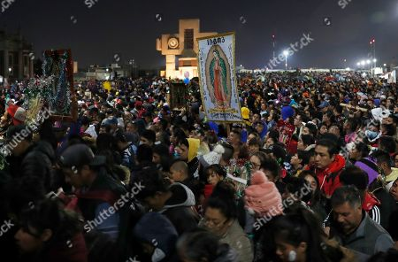 Pilgrims arrive to the plaza outside the Basilica of Guadalupe in Mexico City, . Officials estimated a crowd of 9.8 million in the area surrounding one of the Roman Catholic world's holiest shrines, according to national civil defense coordinator David Leon. If so, that would exceed the population of Mexico City itself