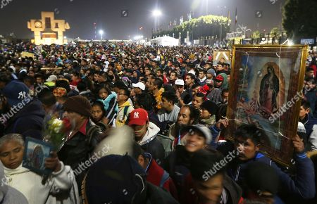 Stock Photo of Pilgrims arrive to the plaza outside the Basilica of Guadalupe in Mexico City, . Officials estimated a crowd of 9.8 million in the area surrounding one of the Roman Catholic world's holiest shrines, according to national civil defense coordinator David Leon. If so, that would exceed the population of Mexico City itself