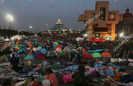 Pilgrims sleep overnight outside the Basilica of Guadalupe in Mexico City, . Officials estimated a crowd of 9.8 million in the area surrounding one of the Roman Catholic world's holiest shrines, according to national civil defense coordinator David Leon. If so, that would exceed the population of Mexico City itself