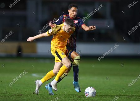 Lewis Collins of Newport County and Kurtis Guthrie of Stevenage in action