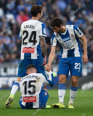 Esteban Granero of RCD Espanyol helps David Lopez after his injury