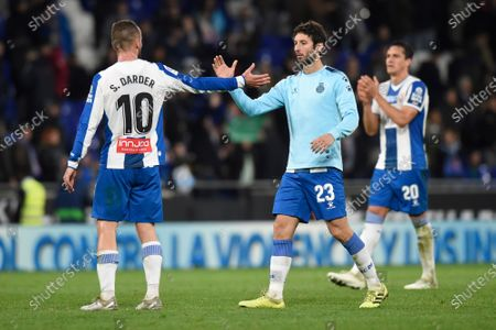 Stock Photo of Sergi Darder of RCD Espanyol greets his teammate Esteban Granero at full time