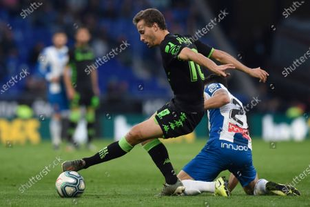 Stock Photo of Sergio Canales of Real Betis and Marc Roca of RCD Espanyol