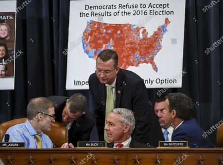 Representative Doug Collins, a Republican from Georgia and ranking member of the House Judiciary Committee,  (standing) talks with (L-R) Representative Jim Jordan, a Republican from Ohio, Representative Ken Buck, a Republican from Colorado and  Representative John Ratcliffe, a Republican from Texas,  during a House Judiciary Committee markup of Articles of Impeachment against US President Donald J. Trump at the Longworth House Office Building on Capitol Hill in Washington, DC, USA, 12 December 2019. The House Judiciary Committee has written two articles of impeachment accusing US President Donald J. Trump of abuse of power and obstruction of Congress. The committee is expected to vote on the two articles, 12 December, setting up a vote on the House floor next week.
