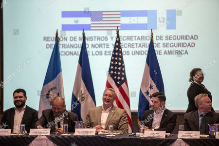 Salvadoran Minister of Justice and Security Rogelio Eduardo Rivas, left, Honduran Minister of Security Julian Pacheco, second left, Guatemalan Interior Minister Enrique Degenhart, center, Acting Secretary of Homeland Security Chad F. Wolf, second right, and U.S. Deputy chief of mission David Hodge laugh during a conference of minters in Guatemala City