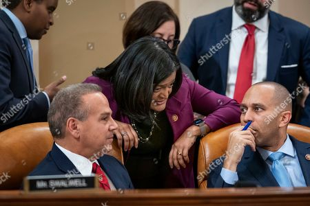 David Cicilline, Pramila Jayapal, Hakeem Jeffries. From left, Rep. David Cicilline, D-R.I., Rep. Pramila Jayapal, D-Wash., and Rep. Hakeem Jeffries, D-N.Y., talk as the House Judiciary Committee marks up articles of impeachment against President Donald Trump, on Capitol Hill in Washington