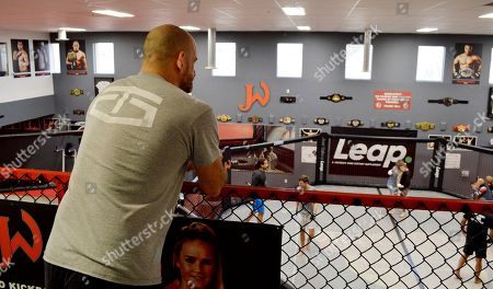 """Greg Jackson, co-owner of Jackson Wink MMA Academy, stands about his training facility, in Albuquerque, New Mexico. The storied mixed martial arts gym, that has trained UFC Light Heavyweight Champion Jon """"Bones"""" Jones and other notable fighters, announced Wednesday it will offer naming rights to its facility"""