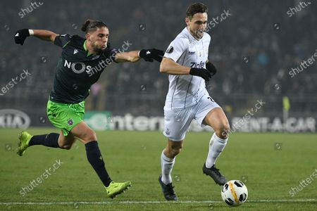 Sporting's Pedro Mendes (L) and LASK'S James Holland (R) in action during the UEFA Europa League group D soccer match between LASK Linz and Sporting CP in Linz, Austria, 12 December 2019.