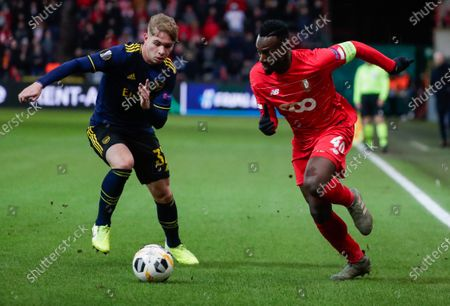 Stock Image of Emile Smith Rowe (L) of Arsenal in action against Paul Jose Mpoku (R) of Liege during the UEFA Europa League group F soccer match between Standard Liege and Arsenal FC at Stade Maurice Dufrasne in Liege, Belgium, 12 December 2019.