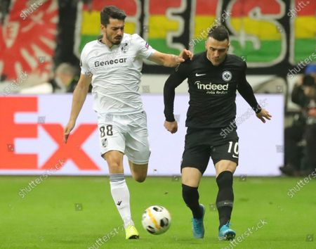 Vitoria Guimarae's Pedro Rodrigues in action against Frankfurt's Filip Kostic (R) during the UEFA Europa League Group F match between Eintracht Frankfurt and Vitoria Guimaraes in Frankfurt Main, Germany, 12 December 2019.