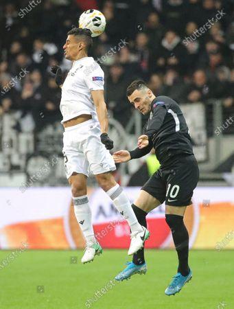 Vitoria Guimarae's Victor Garcia in action against Frankfurt's Filip Kostic during the UEFA Europa League Group F match between Eintracht Frankfurt and Vitoria Guimaraes in Frankfurt Main, Germany, 12 December 2019.