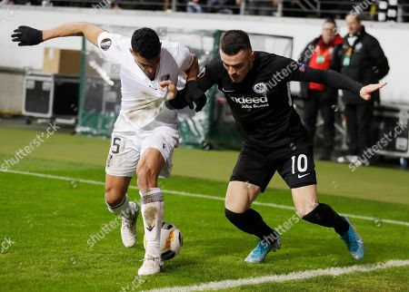 Frankfurt's Filip Kostic, right, and Vitoria's Victor Garcia challenge for the ball during a group F Europa League match between Eintracht Frankfurt and Vitoria SC in Frankfurt, Germany