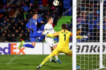 Getafe CF's Nemanja Maksimovic (L) in action against FC Krasnodar's Uros Spajic (C) and goalkeeper Stanislav Kritsyuk during a UEFA Europe League Group C match between Getafe CF and FC Krasnodar at the Coliseum Alfonso Perez stadium in Madrid, Spain, 12 December 2019.