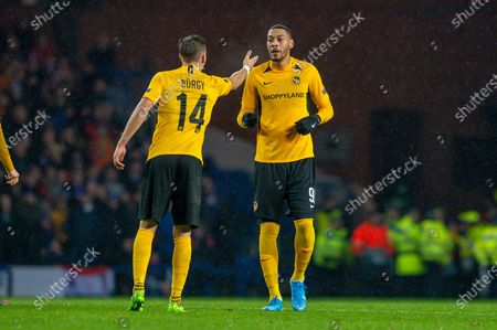 Nicolas Burgy (#14) of BSC Young Boys speaks with Guillaume Hoarau (#99) of BSC Young Boys during the Europa League Group G match between Rangers FC and BSC Young Boys at Ibrox Park, Glasgow