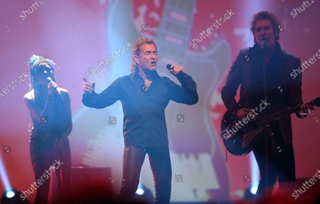 Stock Picture of Peter Maffay (C) performs during the Jose Carreras Gala Christmas concert in Leipzig, Germany, 12 December 2019. The 25th Jose Carreras Gala is one of the most successful charity events in German television and raises funds for the Spanish tenor's leukemia foundation.