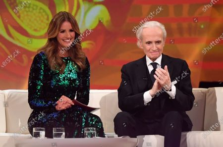 Stock Photo of German television presenter Mareile Hoeppner and Spanish tenor Jose Carreras (R) smile during the Jose Carreras Gala Christmas concert in Leipzig, Germany, 12 December 2019. The 25th Jose Carreras Gala is one of the most successful charity events in German television and raises funds for the Spanish tenor's leukemia foundation.