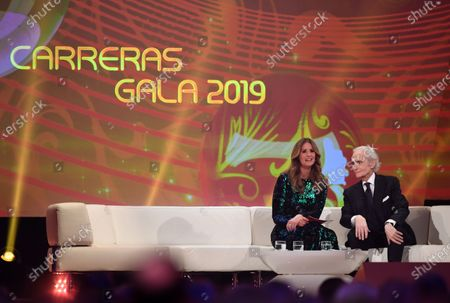 German television presenter Mareile Hoeppner and Spanish tenor Jose Carreras (R) smile during the Jose Carreras Gala Christmas concert in Leipzig, Germany, 12 December 2019. The 25th Jose Carreras Gala is one of the most successful charity events in German television and raises funds for the Spanish tenor's leukemia foundation.