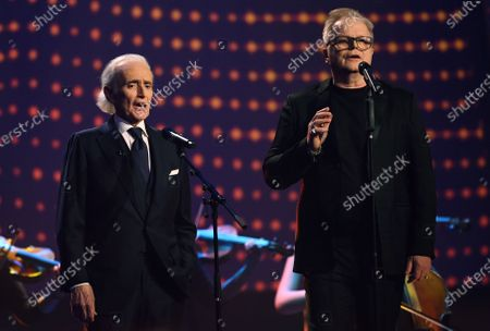 Stock Image of Spanish tenor Jose Carreras (L) and German singer Herbert Groenemeyer perform on stage during the Jose Carreras Gala Christmas concert in Leipzig, Germany, 12 December 2019. The 25th Jose Carreras Gala is one of the most successful charity events in German television and raises funds for the Spanish tenor's leukemia foundation.