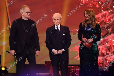 Spanish tenor Jose Carreras (C), German singer Herbert Groenemeyer (L) and German television presenter Mareile Hoeppner stand on stage during the Jose Carreras Gala Christmas concert in Leipzig, Germany, 12 December 2019. The 25th Jose Carreras Gala is one of the most successful charity events in German television and raises funds for the Spanish tenor's leukemia foundation.