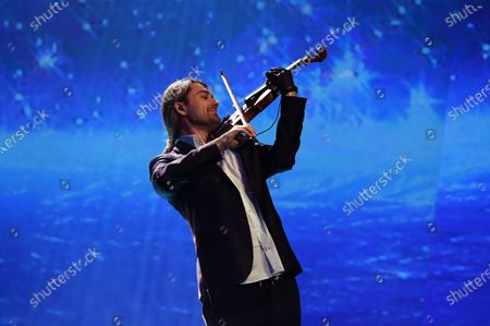 German violinist David Garrett performs on stage during the Jose Carreras Gala Christmas concert in Leipzig, Germany, 12 December 2019. The 25th Jose Carreras Gala is one of the most successful charity events in German television and raises funds for the Spanish tenor's leukemia foundation.