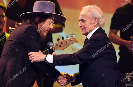 Zucchero (L) shakes hand Spanish tenor Jose Carreras on stage during the Jose Carreras Gala Christmas concert in Leipzig, Germany, 12 December 2019. The 25th Jose Carreras Gala is one of the most successful charity events in German television and raises funds for the Spanish tenor's leukemia foundation.