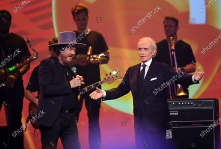 Zucchero (L) and Spanish tenor Jose Carreras stand on stage during the Jose Carreras Gala Christmas concert in Leipzig, Germany, 12 December 2019. The 25th Jose Carreras Gala is one of the most successful charity events in German television and raises funds for the Spanish tenor's leukemia foundation.