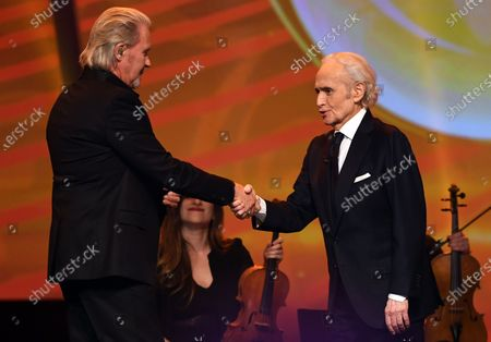 Johnny Logan (L) with Spanish tenor Jose Carreras (R) on stage during the Jose Carreras Gala Christmas concert in Leipzig, Germany, 12 December 2019. The 25th Jose Carreras Gala is one of the most successful charity events in German television and raises funds for the Spanish tenor's leukemia foundation.