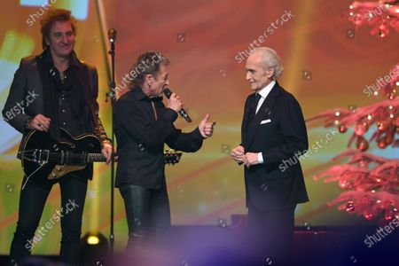 Spanish tenor Jose Carreras (R) talks with German singer Peter Maffay (C) during the Jose Carreras Gala Christmas concert in Leipzig, Germany, 12 December 2019. The 25th Jose Carreras Gala is one of the most successful charity events in German television and raises funds for the Spanish tenor's leukemia foundation.
