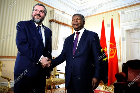 Brazilian Foreign Minister Ernesto Araujo (L) meets with Angola's President Joao Lourenco (R) during a visit to Luanda, Angola, 12 December 2019. The Brazilian Foreign Minister continues his visit to the African continent, which includes Cape Verde, Senegal, Nigeria and Angola, in order to discuss issues related to defense, security, trade and investment until 13 December.