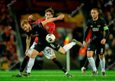 Manchester United's James Garner (L) in action with AZ Alkmaar's Fredrik Midtsjo (R) during the UEFA Europa League group L soccer match between Manchester United and AZ Alkmaar held at Old Trafford in Manchester, Britain, 12 December 2019.