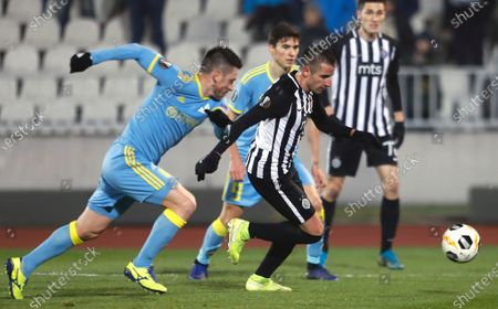 Partizan's Zoran Tosic (R) and Astana's Antonio Rukavina (L) in action during the UEFA Europa League Group L match between Partizan and Astana in Belgrade, Serbia, 12 December 2019.
