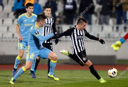 Stock Photo of Partizan's Zoran Tosic (R) in action against Astana's Antonio Rukavina (L) during the UEFA Europa League Group L match between Partizan and Astana in Belgrade, Serbia, 12 December 2019.