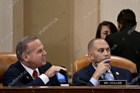 United States Representative David Cicilline (Democrat of Rhode Island), left, speaks as US Representative Hakeem Jeffries (Democrat of New York) and chair of the Democratic Caucus, right, listens during a US House Judiciary Committee hearing. The Committee is set to finish debating articles of impeachment against US President Donald J. Trump today with a likely party-line vote to send the resolution to the floor of the US House of Representatives.