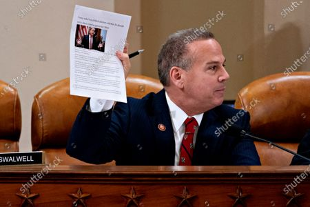United States Representative David Cicilline (Democrat of Rhode Island), holds a news article while speaking during a US House Judiciary Committee hearing