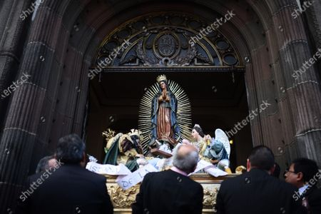 Stock Picture of Faithful Catholics participate in the celebration of the Day of the Virgin of Guadalupe, in Guatemala City, Guatemala, 12 December 2019. Millions of faithful in Central America and around the world worship The Virgin of Guadalupe. According to the legend, Our Lady of Guadalupe appeared on 12 December 1531 on the top of Tepeyac Hill, to the indigenous Juan Diego, who was canonized in 2002 by Pope John Paul II.