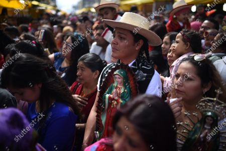 Faithful Catholics participate in the celebration of the Day of the Virgin of Guadalupe, in Guatemala City, Guatemala, 12 December 2019. Millions of faithful in Central America and around the world worship The Virgin of Guadalupe. According to the legend, Our Lady of Guadalupe appeared on 12 December 1531 on the top of Tepeyac Hill, to the indigenous Juan Diego, who was canonized in 2002 by Pope John Paul II.