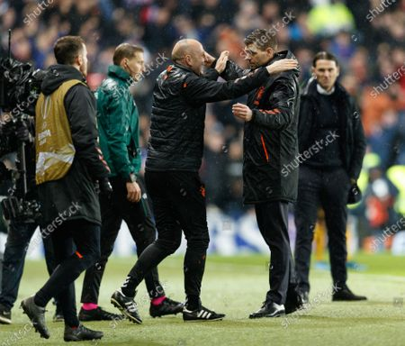 Rangers Assistant Manager Gary McAllister & Rangers Manager Steven Gerrard celebrate as the final whistle sounds. Rangers qualified for the last 32 of the Europa League after drawing 1-1 tonight.