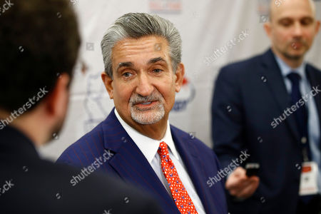 Washington Capitals team owner Ted Leonsis speaks with members of the press before accepting the Wayne Gretzky International Award on behalf of Capitals left wing Alex Ovechkin at a U.S. Hockey Hall of Fame ceremony, in Washington