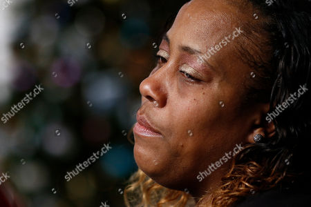 Kimberly Williams tears up as she remembers her late son Jarvis Birtfield, 19, who was killed last year in Jackson, during a tree lighting ceremony honoring victims of violent criminal acts and recognizing the surviving family members of the homicide victims, in Jackson, Miss