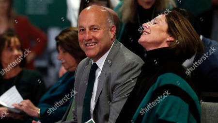 R m. Steve Addazio, left, jokes with his wife, Kathy, during an announcement that he has been hired as the new head football coach at Colorado State University at a news conference at the school, in Fort Collins, Colo