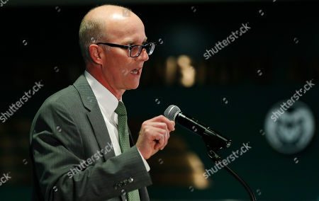 R m. Joe Parker, athletic director at Colorado State University, makes a point during an announcement that Steve Addazio has been hired as the new head football coach at the school at a news conference at the school, in Fort Collins, Colo