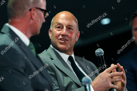 Stock Photo of R m. Colorado State head coach Steve Addazio, back, chats with athletic director Joe Parker during an announcement that Addazio has been hired as the new head football coach at a news conference at the school, in Fort Collins, Colo