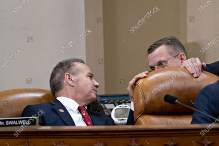 Representative Doug Collins (R), a Republican from Georgia and ranking member of the House Judiciary Committee, talks to Representative David Cicilline (L), a Democrat from Rhode Island, during a hearing on Capitol Hill in Washington, DC, USA, 12 December 2019. The House Judiciary Committee has written two articles of impeachment accusing US President Donald J. Trump of abuse of power and obstruction of Congress. The committee is expected to vote on the two articles, 12 December, setting up a vote on the House floor next week.
