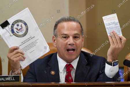 United States Representative David Cicilline (Democrat of Rhode Island), holds up a copy of the Constitution of the United States and the Trump-Ukraine Impeachment inquiry report during a US House Judiciary Committee markup of Articles of Impeachment against President Donald Trump at the Longworth House Office Building in Washington, DC.