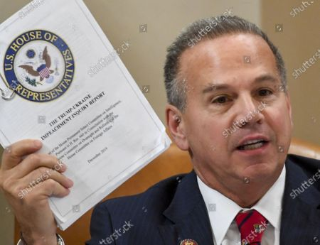 United States Representative David Cicilline (Democrat of Rhode Island), holds up a copy of the Trump-Ukraine Impeachment inquiry report during a US House Judiciary Committee markup of Articles of Impeachment against President Donald Trump at the Longworth House Office Building in Washington, DC.