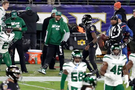 New York Jets strong safety Jamal Adams, center left, talks with Baltimore Ravens quarterback Lamar Jackson (8) during the first half of an NFL football game, in Baltimore