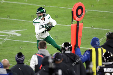 New York Jets wide receiver Robby Anderson (11) runs with the ball after making a catch on a pass from quarterback Sam Darnold, not visible, during the first half of an NFL football game against the Baltimore Ravens, in Baltimore